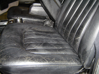 Worn and faded Rolls Royce leather seat