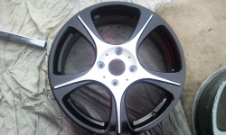 Alloy wheel after being colour coded black and white